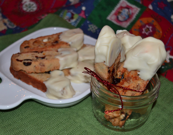 cranberry orange biscotti dipped in white chocolate.