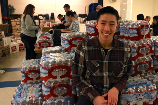 Eddie Wang poses during a Sleepless in Seattle volunteer event
