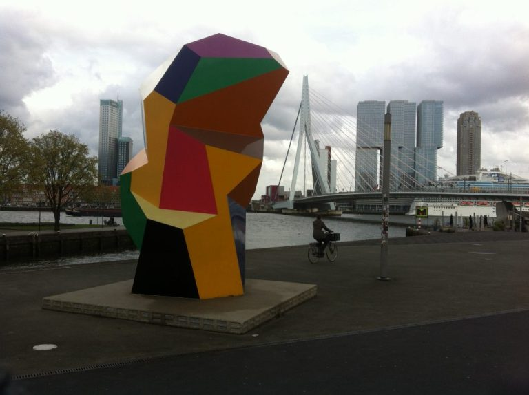Architecture, art and cyclist in Rotterdam, Netherlands