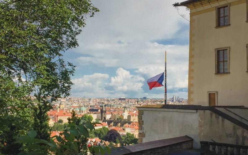 waving czech republic flag at prague castle