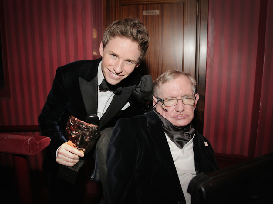 Eddie Redmayne, Leading Actor winner for The Theory of Everything, with Stephen Hawking. Image: BAFTA/Hannah Taylor