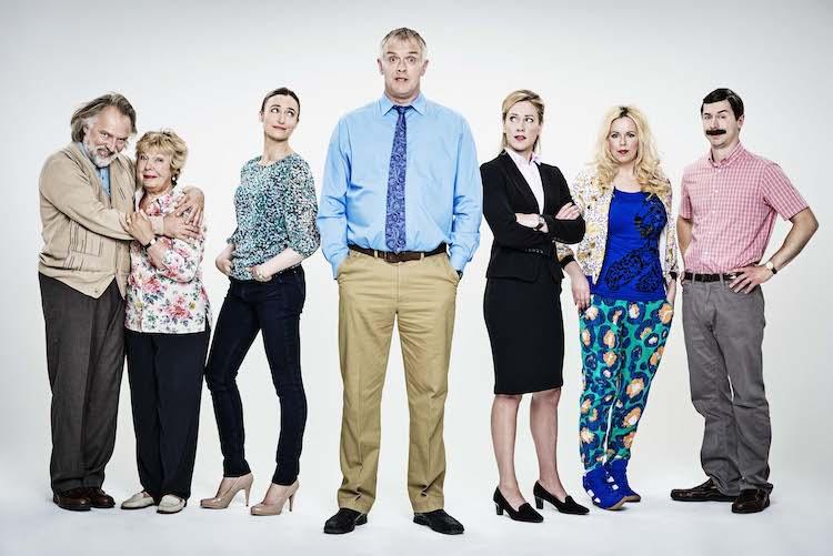 l-r:  Dad (Rik Mayall), Mum (Gwyneth Powell), Naomi (Deirdre Mullins), Dan (Greg Davies), Miss Lipsey (Jeany Spark), Jo (Roisin Conaty), Brian (Mike Wozniak). Image: Channel 4