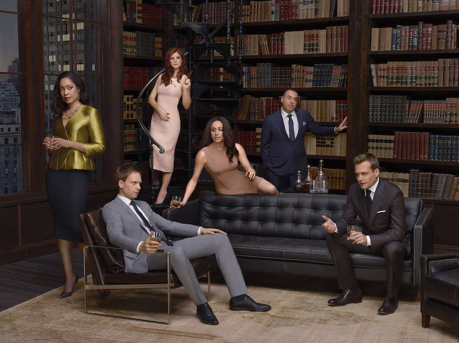 L-R: Gina Torres as Jessica Pearson, Patrick J Adams as Mike Ross, Sarah Rafferty as Donna Paulsen, Meghan Merkle as Rachel Zane, Rick Hoffman as Louis Litt and Gabriel Macht as Harvey Specter. Image: UKTV.