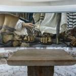 Encounter Chapel mural, by Chilean artist Daniel Cariola, depicts the woman who sought healing by touching the hem of Jesus' cloak in Mark 5:25-34 (Seetheholyland.net)