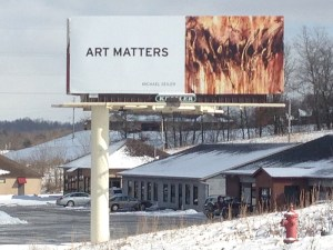 Art Matters billboard campaign for the artists in the Zanesville Artist Colony, Michael Seiler asphalt painting, Dances with Fire.