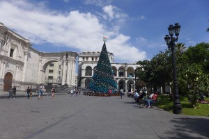 Christmas tree decorated in blue and silver glass balls in middle of plaza