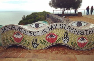 "sculpture at top of signal hill that reads ""your respect is my strength"""