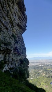 View of the city along side enormous castle rock