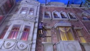 Mackenzie climbs a building at Kidzania