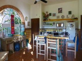view of bright sunny kitchen with the word HOLA on the wall