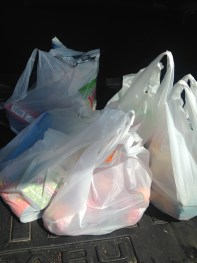 5 plastic bags filled with groceries