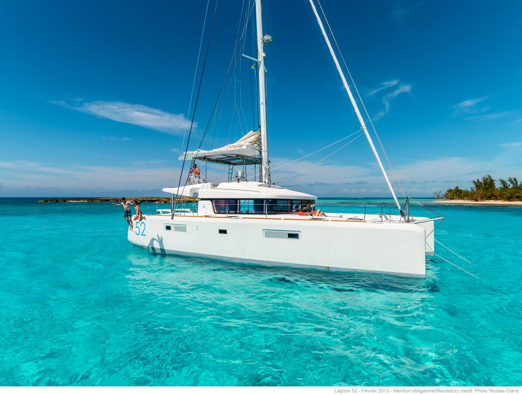 Freedom Luxury Charter Sailing Catamaran Guests Jumping