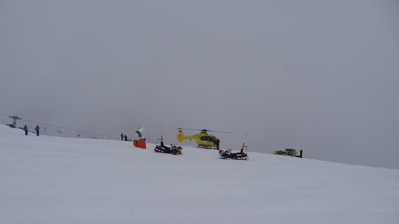 Rescue helicopter on the ski slope