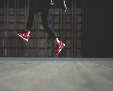 Person Jumping Red Shoes