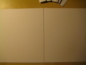 Draw a horizontal line in the center of the poster board.