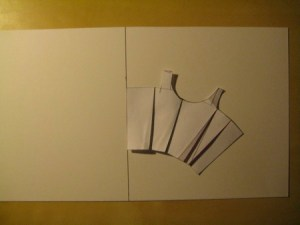 Line up the paper block so that the Center Back line is against the horizontal line on the poster board.