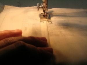 Sew, just inside the folded edge.