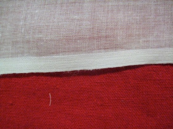 The selvedge edge of fabric is completely finished, and often more densely woven than the body of the cloth..