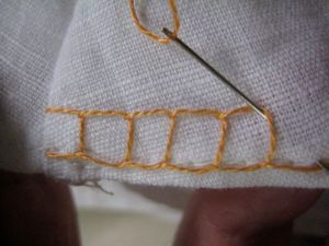 repeating the stitch to create a row of squares