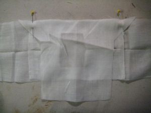 sleeve pinned in place