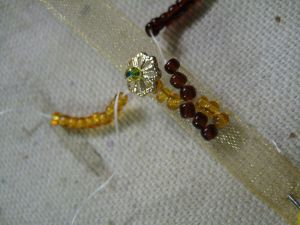bezant and bead on thread