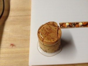glueing cork in place