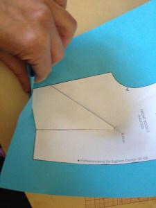 Our dart jog here also crosses the bottom edge of the sloper.  We need to fold along the bottom edge of the sloper.  This is so that the dart jog does not end up longer than the bottom of the bodice.