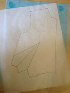 Put a piece of plain paper under the tracing paper.  Make sure you see the whole outline and the dart.