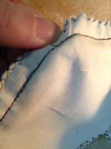 I've snipped the offending threads on the body side of the new join.  The threads on the seam allowance side are only a problen for me if I decide to press the seam open, so I've just decided not to do that. I'll press all the seams as though I plan to topstitch them.