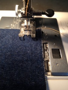 Sew at your normal seam allowance.  This is a permanent seam, so backtack at the start and end.  Do not clip your starting threads yet.