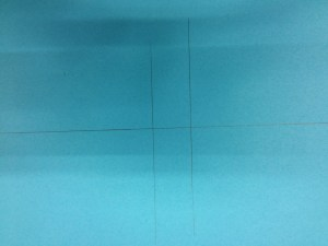 """Make guides on your colored paper.  The horizontal one will let us line all the pieces back up, based on their horizontal balance lines.  The two vertical lines are absolutely square to that.  The distance between them is the amount of fullness we're adding at the center of the sleeve: 1""""."""