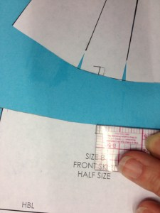 Here comes the tricky part: Move the skirt notch over towards the side by the measurement of the center-most yoke opening.  This is so that your notches will line up when you sew.