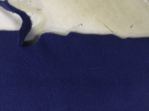 Result of fabric wrinkling during cutting.