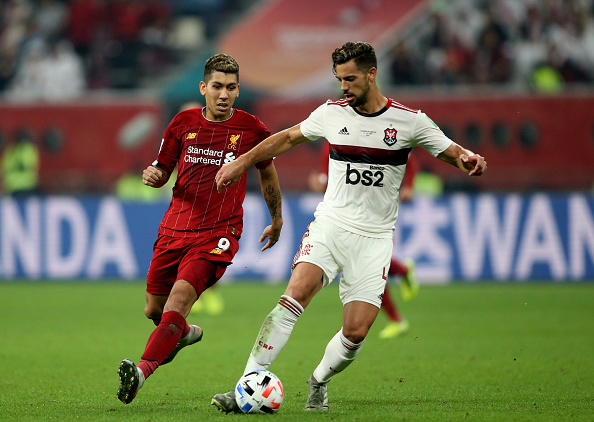 Pablo Mari of CR Flamengo competes for the ball with Roberto Firmino of Liverpool during the FIFA Club World Cup Final Match between Liverpool FC and CR Flamengo at Khalifa International Stadium on December 21, 2019 in Doha, Qatar.