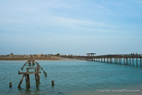 The remains of the old bridge have long been forgotten since erecting a new bridge connecting the villages of Joal and Fadiout, Senegal. Photo by Marko Preslenkov.