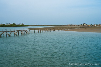 Remains of the old wooden bridge over the lagoon between villages of Joal and Fadiout, Senegal. Photo by Marko Preslenkov.