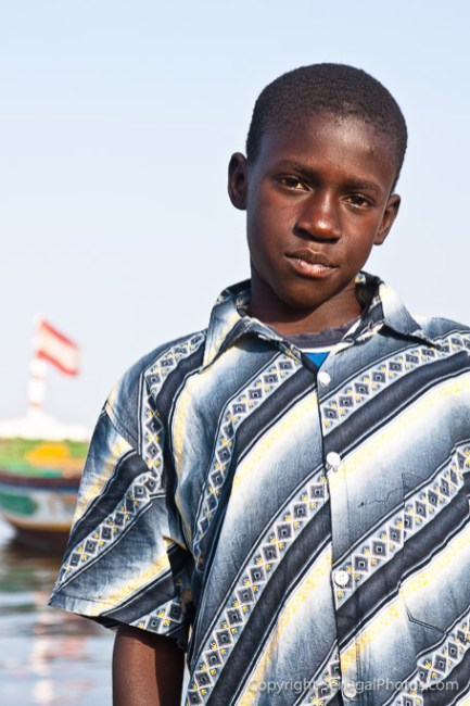 A kid showing off a serious face on the shores of Senegal river in N'Dar Tout quarter of Saint-Louis, Senegal. Photo by Marko Preslenkov.