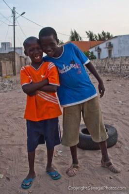 Street of Joal bustling with life in village of Joal-Fadiout on Petite Côte, Senegal. Photo by Marko Preslenkov.