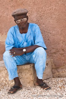 A man contemplating life after burial of much younger villager in Fadiout, Senegal. Photo by Marko Preslenkov.