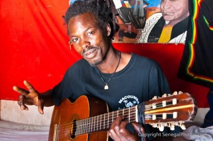 Inside rasta mans hut enjoying the music on the beach in Yoff, Senegal. Photo by Marko Preslenkov.