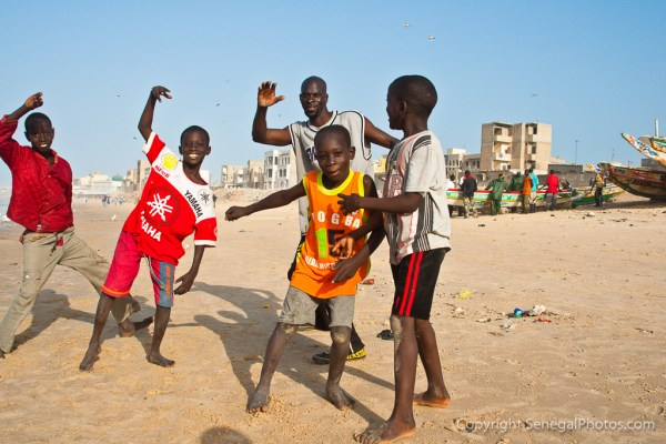 Enjoying the beautiful afternoon on the beach close to Yoff virage with the local fish market going on at the same time in Dakar, Senegal. Photo by Marko Preslenkov.