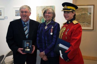 Ron Burchett with Beaver Medal, L-G Guichon, Mountie