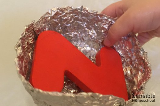 homemade foil boat with red foam letter Z