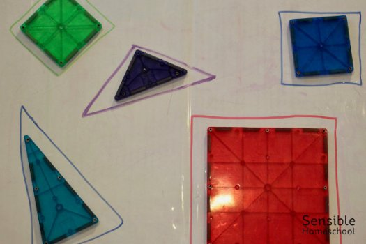 magna-tile shapes on magnetic whiteboard