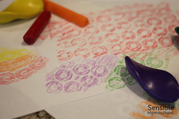 circular crayon rubbings with hole reinforcement labels and rubbing crayons