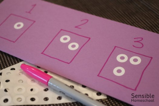 preschool counting activity with hole reinforcement stickers and marker