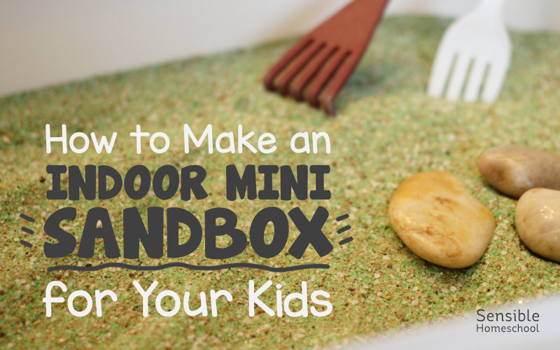 How to Make an Indoor Mini Sandbox for your Kids on green mini-sandbox background with rocks and rakes