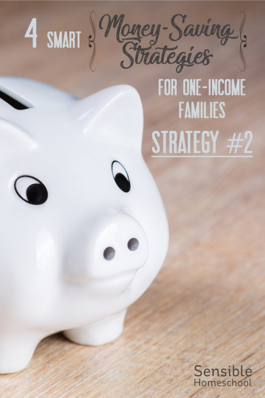4 Smart Money-Saving Strategies for One-Income Families - Strategy #2 title on wood background with piggy bank