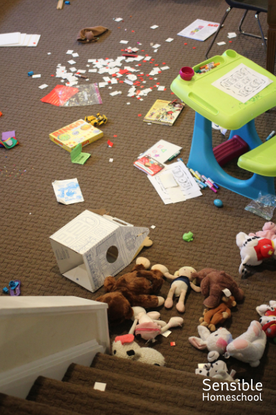 Toys dumped all over messy homeschooling basement