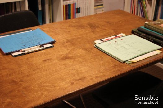 Homeschool wooden table with checklists